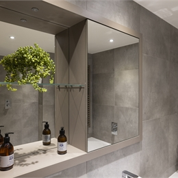 Residential Bathroom Pod with Toilet, Shower in Bath with glass screen across side of bath