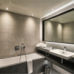 Mosaic Tiled Hotel Bathroom Pod with Flexible Mirror that's Fixated on Wall