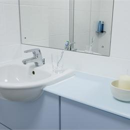 Close Up View of Sink and Mirror in Bathroom Pod
